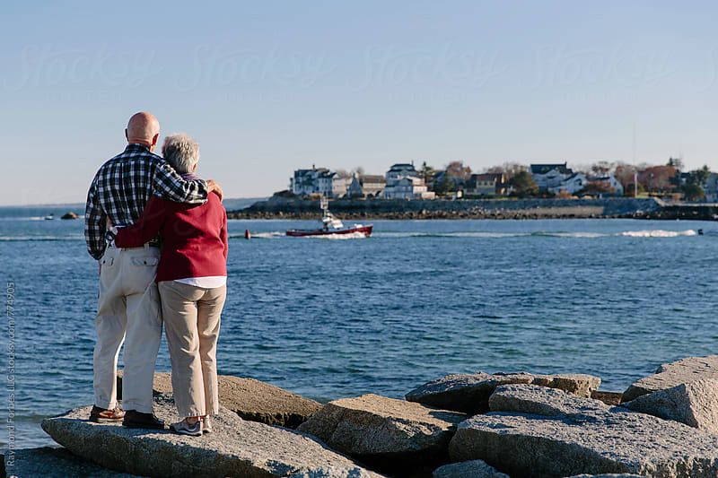 Senior Couple visiting Coastal town by Raymond Forbes LLC for Stocksy United
