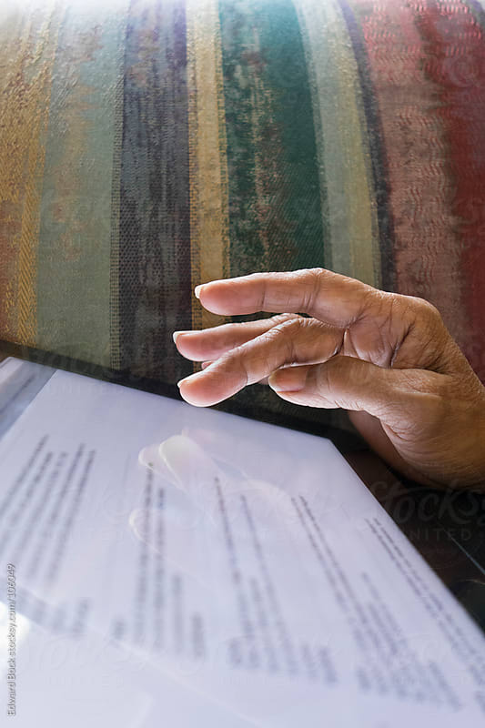 Hand touching a digital tablet by Edward Bock for Stocksy United