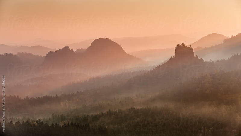 Colorful Sunrise over Hills and Forest by Andreas Wonisch for Stocksy United
