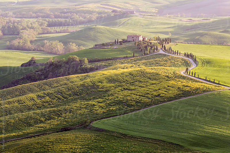 Tuscan houses at sunrise  by Marilar Irastorza for Stocksy United