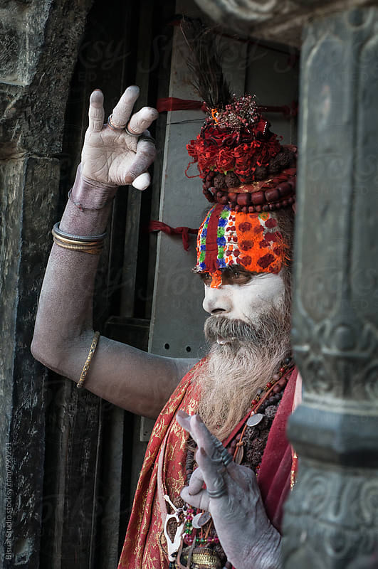 Portrait of a Holy Man praying on  a temple, Kathmandu by Bisual Studio for Stocksy United