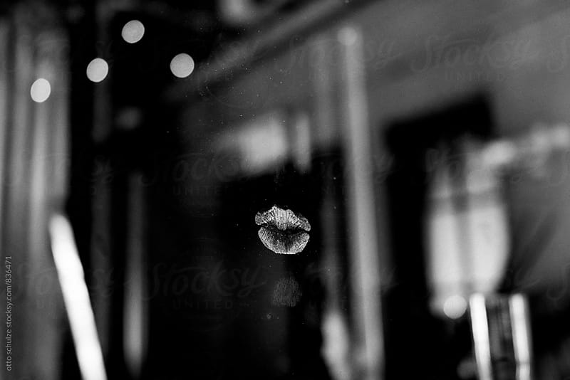 a kiss on a window by otto schulze for Stocksy United
