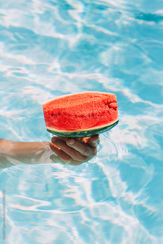 Watermelon in a swimming pool by Giada Canu for Stocksy United