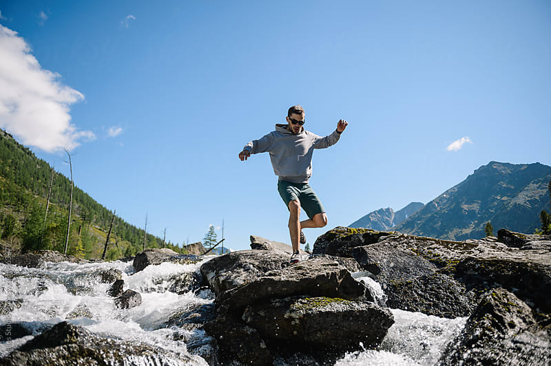 Man jumping through cascade by Milles Studio for Stocksy United