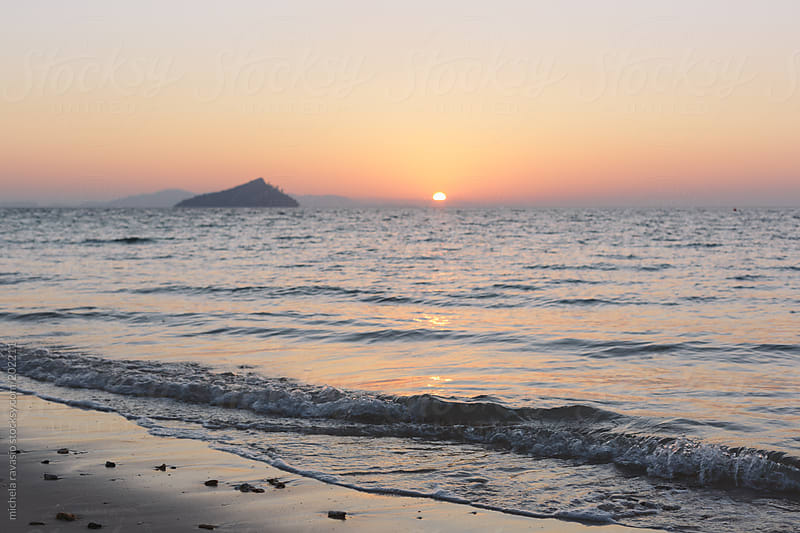 Sunrise from the beach by michela ravasio for Stocksy United