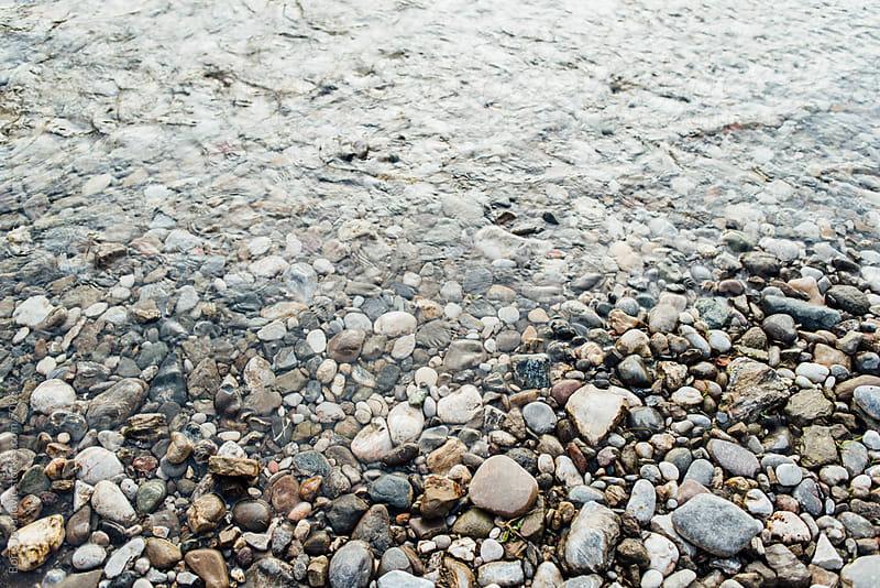 Round rocks on the beach by Boris Jovanovic for Stocksy United