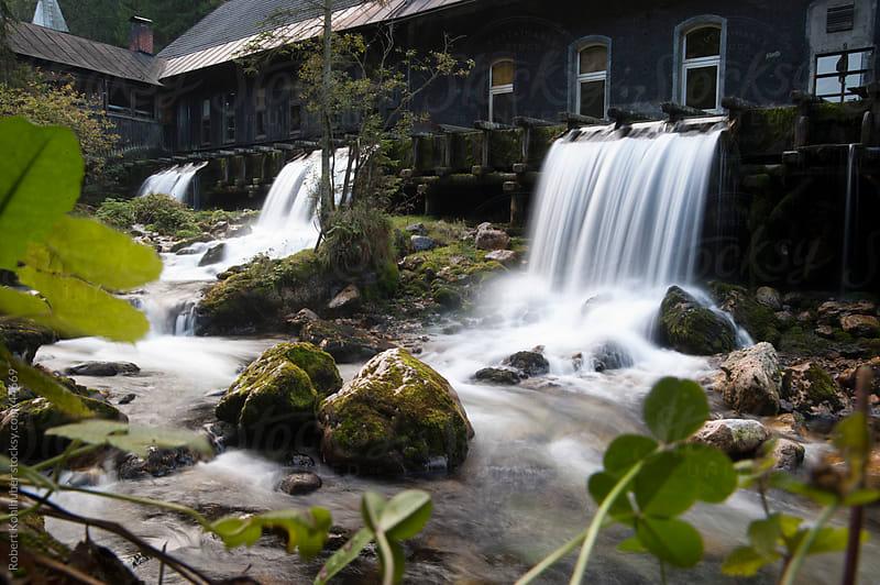 Flowing river by Robert Kohlhuber for Stocksy United