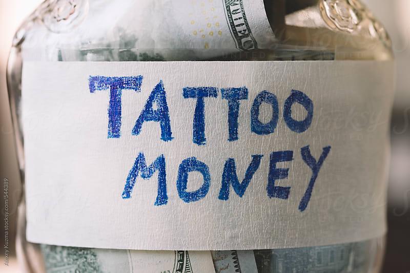 Money for Tattoo by Alexey Kuzma for Stocksy United