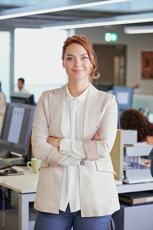 Portrait of attractive business woman team leader entrepenuer in trendy office by Aila Images for Stocksy United