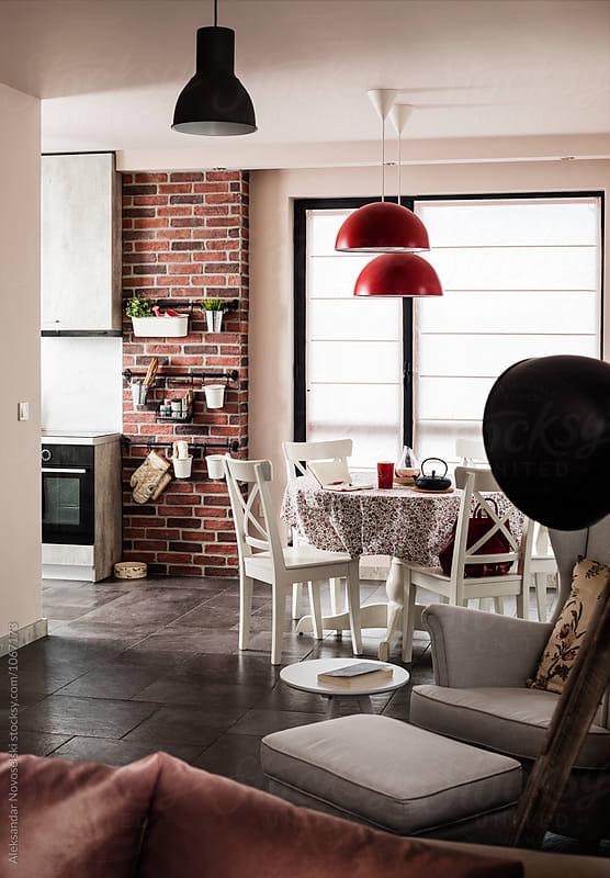 Dining room in contemporary interior by Aleksandar Novoselski for Stocksy United