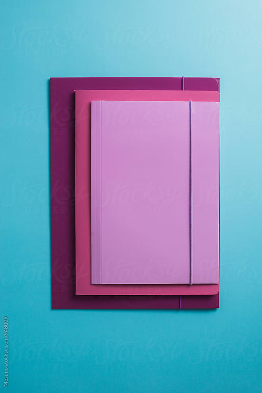 Folders Against Blue Background by Mosuno for Stocksy United