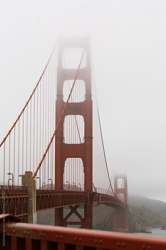 Golden Gate Bridge in a foggy morning by michela ravasio for Stocksy United