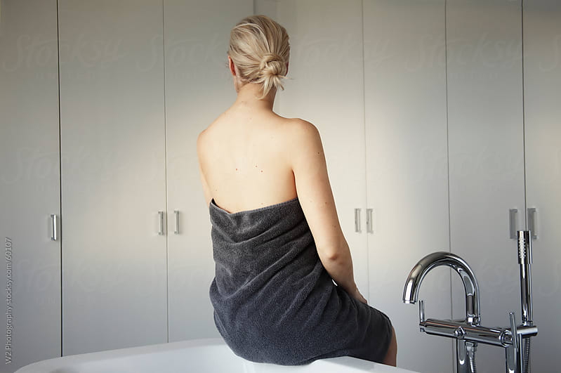 Woman relaxing in a luxurious bathroom after a bath. by W2 Photography for Stocksy United