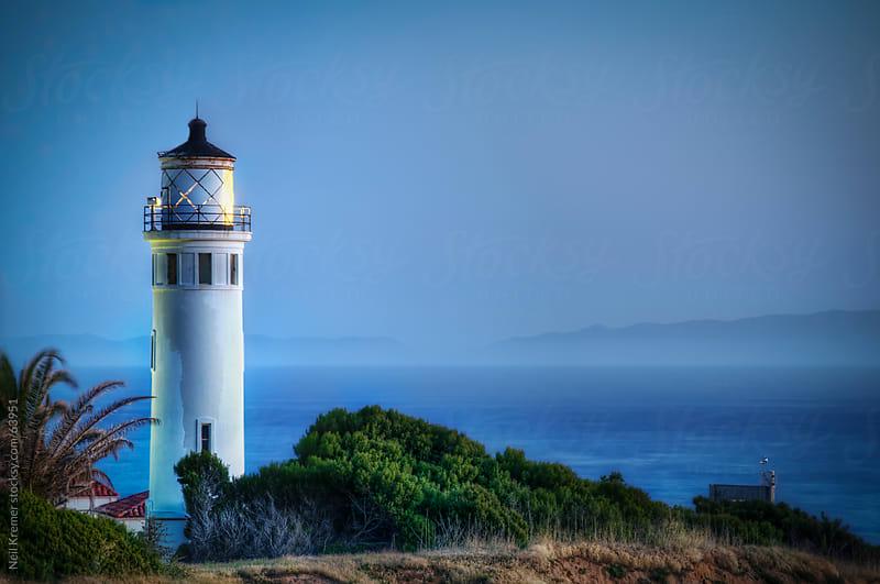 Night lighthouse by Neil Kremer for Stocksy United