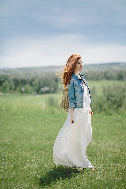 Beautiful young redhead woman walking in nature by Ania Boniecka for Stocksy United