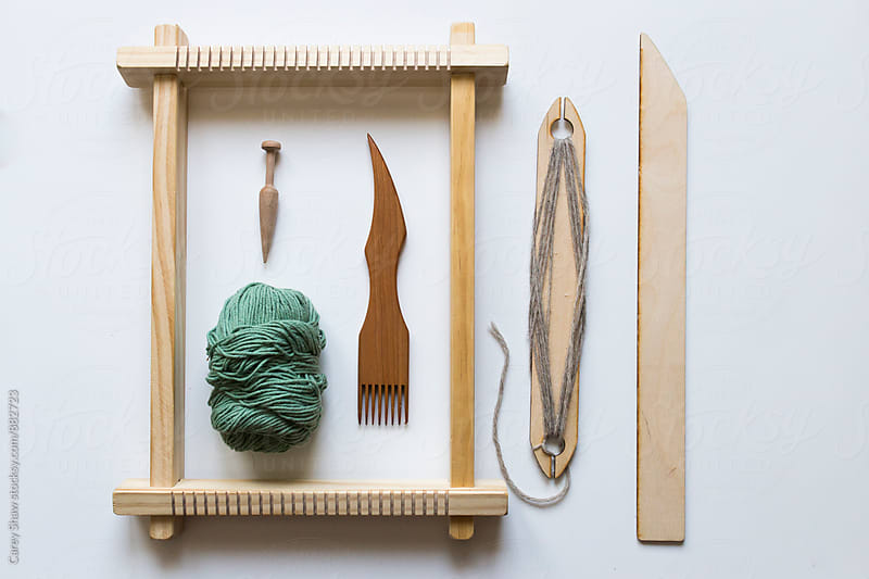 Weaving loom, tools and yarn by Carey Shaw for Stocksy United