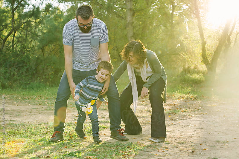 Family playing outdoors  by CACTUS Blai Baules for Stocksy United