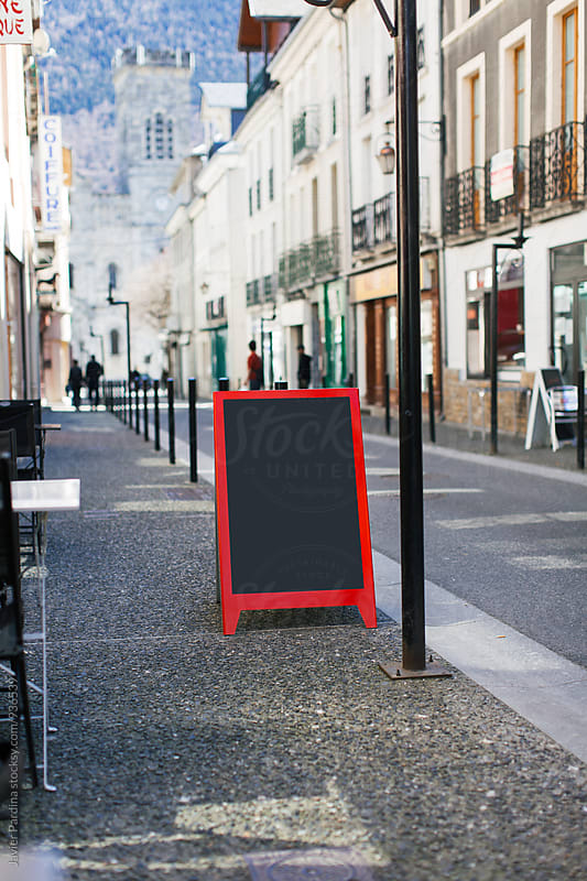 advert bar in street by Javier Pardina for Stocksy United