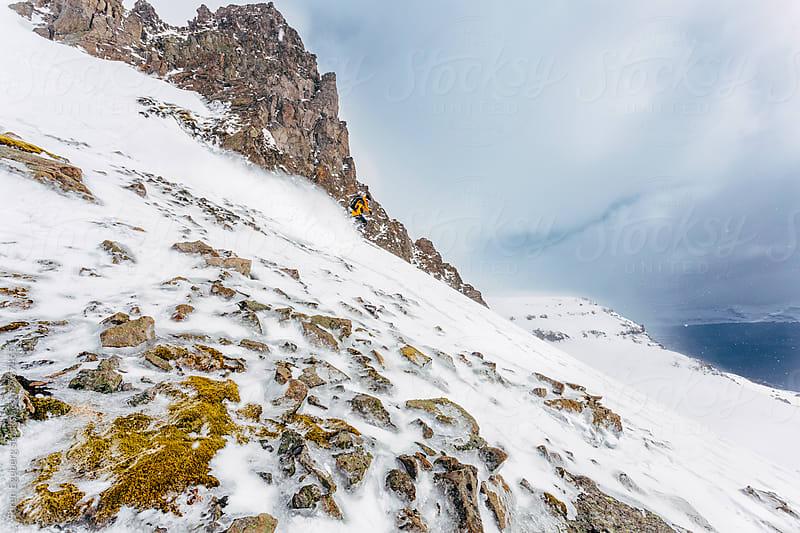 Male skier snow skiing in eastern Iceland fjords by Soren Egeberg for Stocksy United
