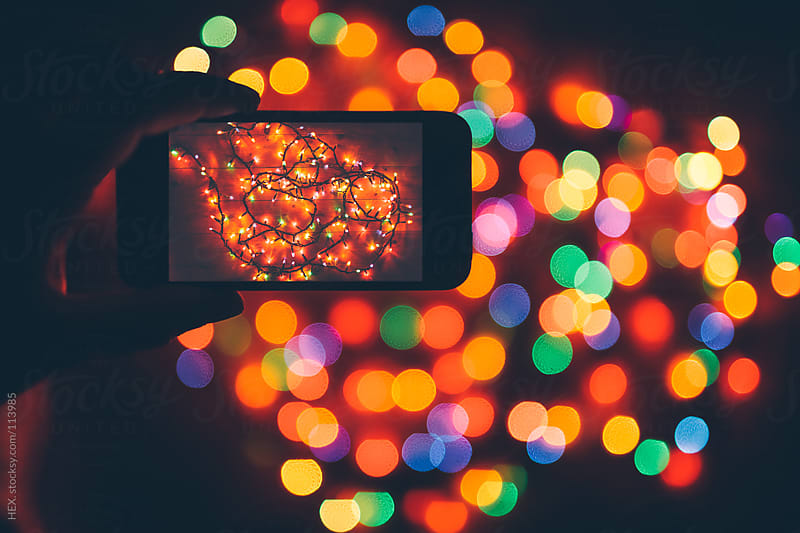Take Picture to Christmas Light with Phone by HEX. for Stocksy United