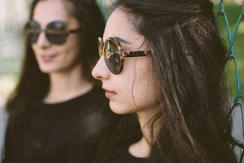 portrait of young women with retro sunglasses . by Alexey Kuzma for Stocksy United