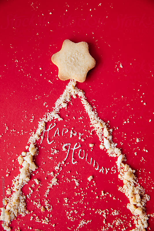 Star on top of a Christmas tree made of biscuit crumbs by Beatrix Boros for Stocksy United