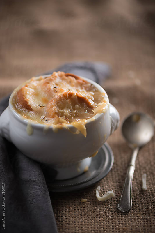 French onion soup with melted gruyere  by Laura Adani for Stocksy United