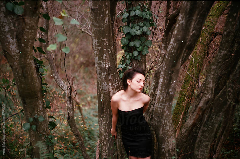 A film portrait of a young beautiful woman in the forest by Anna Malgina for Stocksy United
