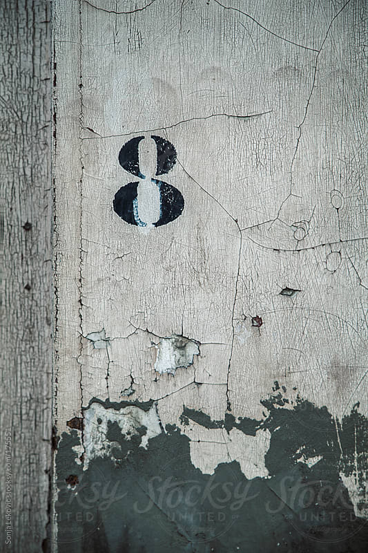 number eight on a wall by Sonja Lekovic for Stocksy United