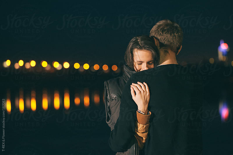 Young hugging pair at night by Danil Nevsky for Stocksy United