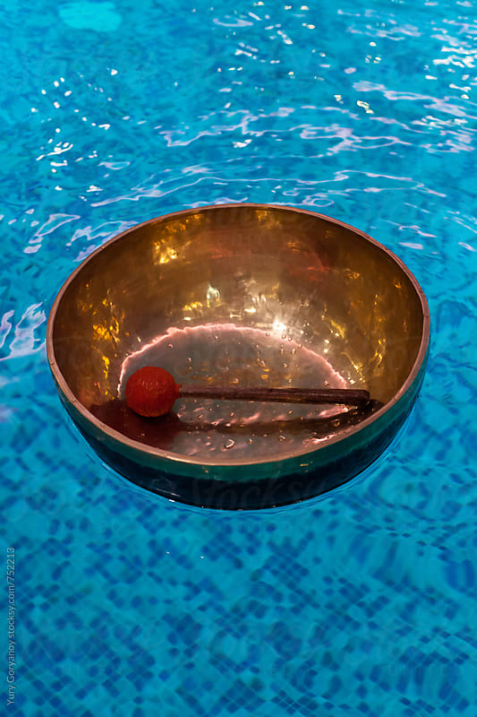 Tibetan bowl on the water by Yury Goryanoy for Stocksy United