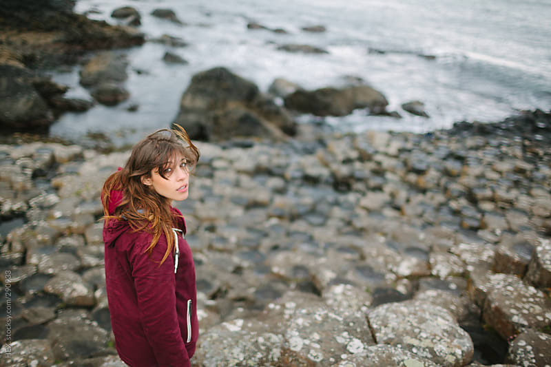 Pretty Young Girl Portrait at Giant's Causeway . Landscape by HEX. for Stocksy United