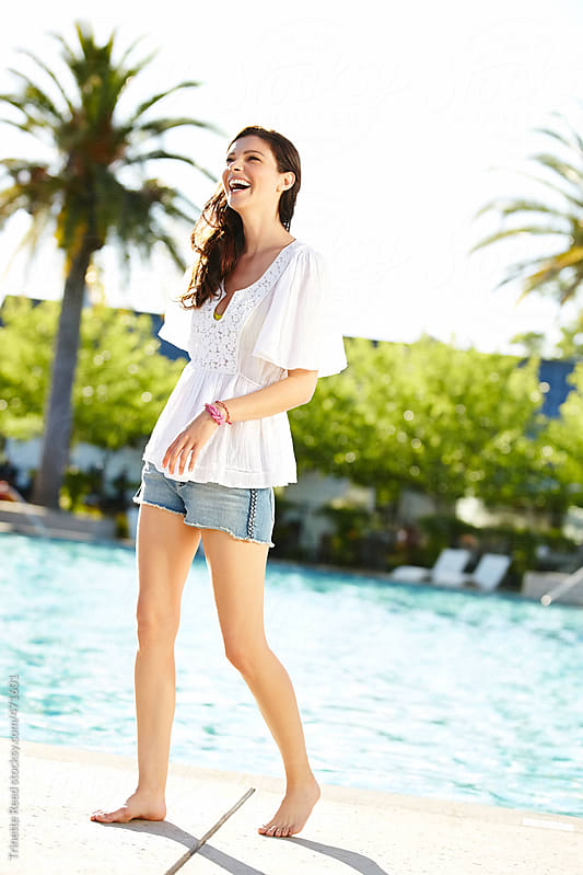Beautiful woman having fun by the pool at luxury resort by Trinette Reed for Stocksy United