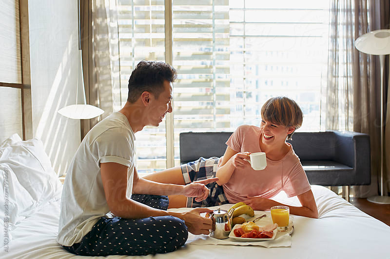 Happy Couple Having Breakfast On Bed by ALTO IMAGES for Stocksy United