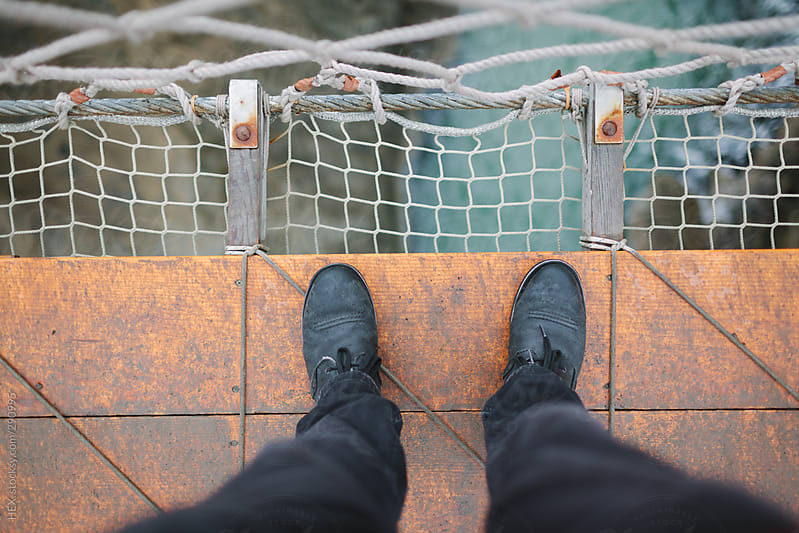 Looking Down at Rope Bridge . Northern Ireland by HEX. for Stocksy United