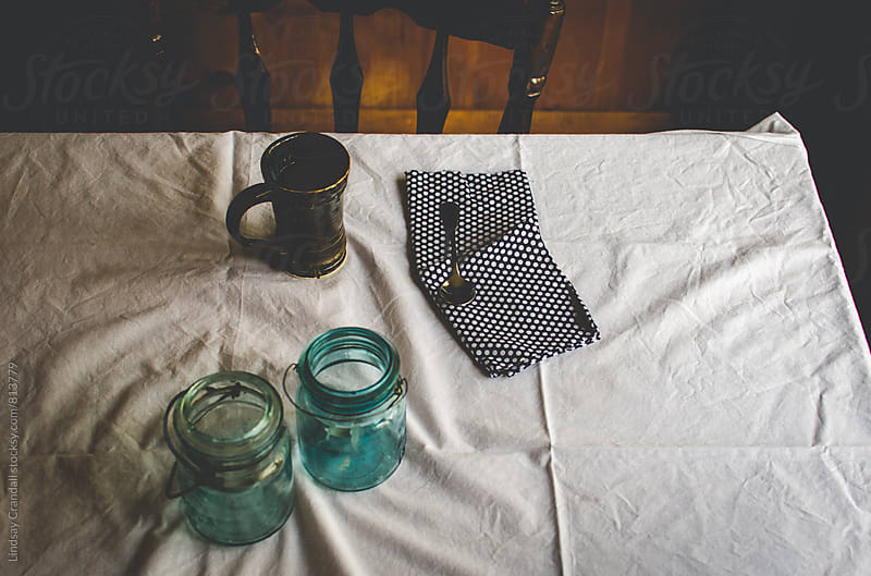 Kitchen table with tea and spoon by Lindsay Crandall for Stocksy United