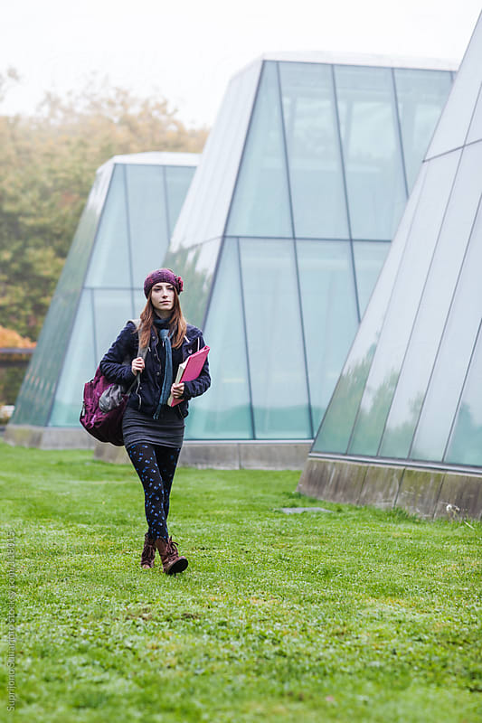Female college student walking on campus by Suprijono Suharjoto for Stocksy United