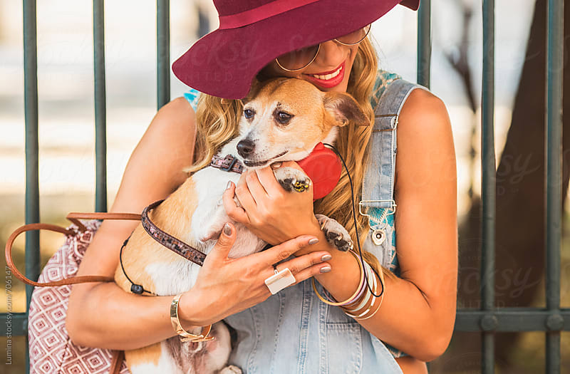 Blonde Woman Holding Her Dog by Lumina for Stocksy United