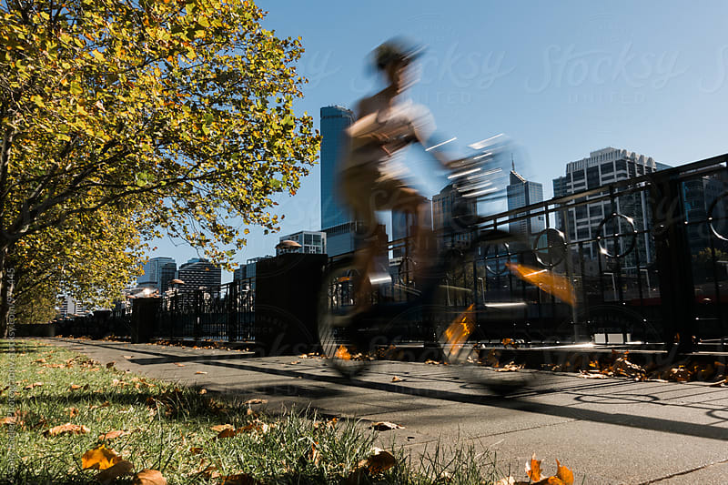 Cyclist on Banks of Yarra in Southbank by Gary Radler Photography for Stocksy United