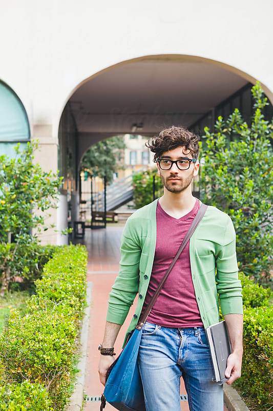 Adult College Student Entering in the Courtyard of the Campus by Giorgio Magini for Stocksy United