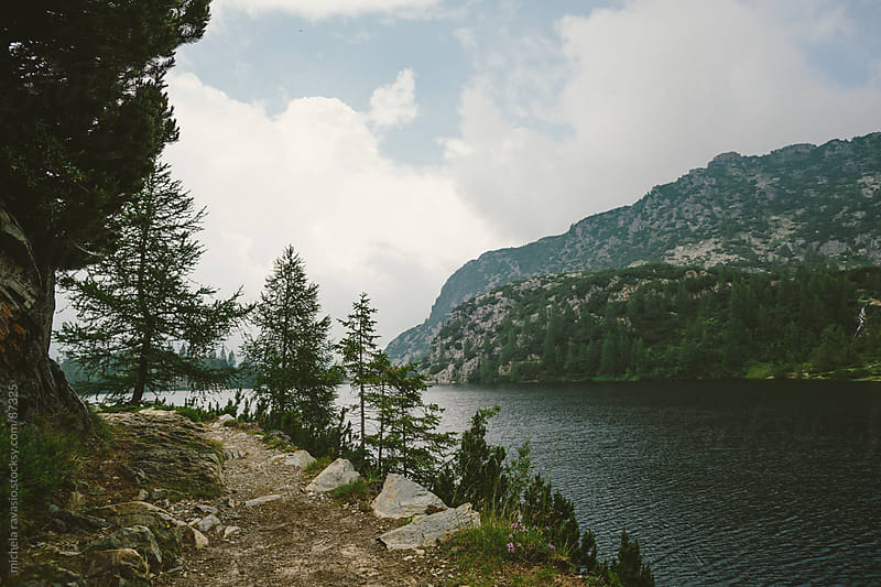 Mountain trail, near lake.  by michela ravasio for Stocksy United