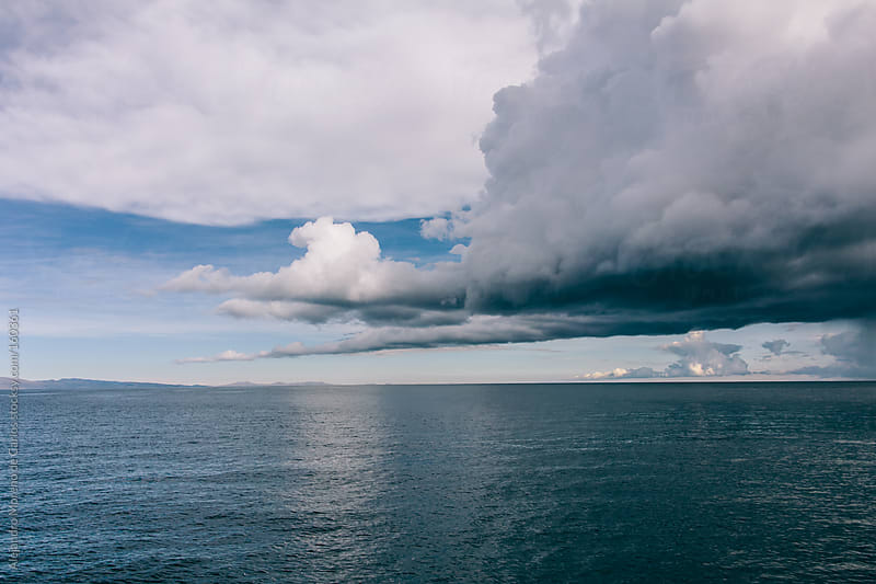 Cloud over lake on a storm in Lake Titicaca, Bolivia by Alejandro Moreno de Carlos for Stocksy United