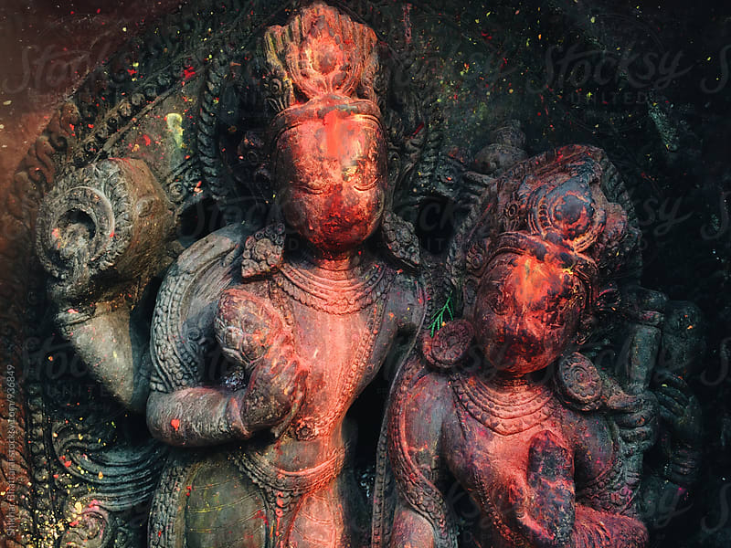 Vermilion covered gods in the streets of Nepal. by Shikhar Bhattarai for Stocksy United