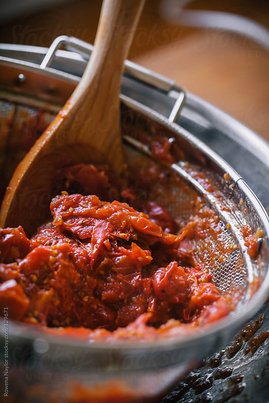 Making Homemade Tomato Passata by Rowena Naylor for Stocksy United