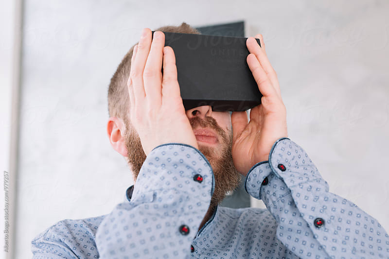 Man wearing VR Reality Headset by Alberto Bogo for Stocksy United