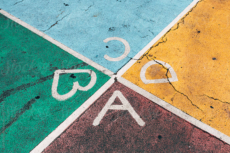 Colored ABCD Squares On Foursquare Court In Playground by Luke Mattson for Stocksy United