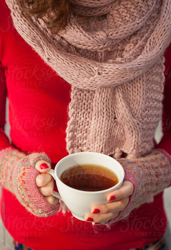Woman in Red Sweater Holding Cup of Tea  by Mosuno for Stocksy United