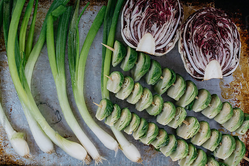 Scallions, radicchio and Brussel sprouts on a tray by Gabriel (Gabi) Bucataru for Stocksy United