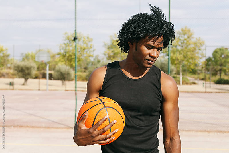 Afro Man Basketball Player in a Street Court by Victor Torres for Stocksy United