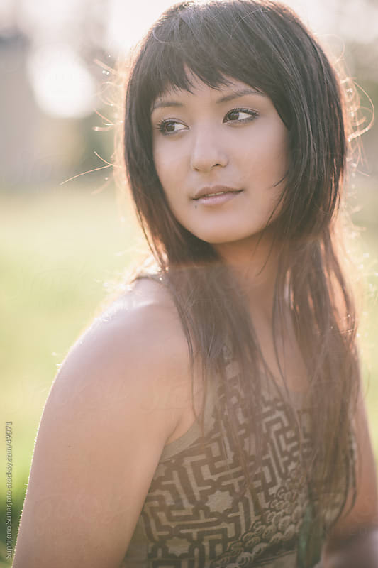 Portrait of a smiling beautiful woman outdoor by Suprijono Suharjoto for Stocksy United